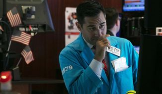 FILE - In this Oct. 2, 2019, file photo specialist William Geier works on the floor of the New York Stock Exchange. The U.S. stock market opens at 9:30 a.m. EDT on Friday, Oct. 18. (AP Photo/Richard Drew, File)
