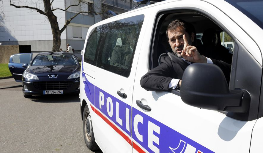 "FILE - In this April 11, 2019 file photo, French Interior Minister Christophe Castaner gestures from a police car as he visits the Neuhof district of Strasbourg, eastern France. One person is in French custody on preliminary terrorism charges after threatening a Sept. 11-style plane hijacking and attack. Christophe Castaner said on France-2 television Thursday Oct. 17, 2019 night that the person was arrested Sept. 26 while ""in the process of planning"" such an attack. (AP Photo/Jean-Francois Badias, File)"
