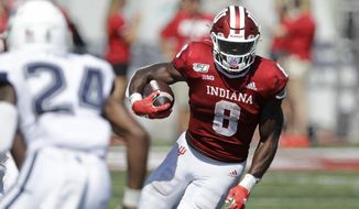 FILE - In this Sept. 21, 2019, file photo, Indiana running back Stevie Scott III (8) runs against Connecticut defensive back Keyshawn Paul (24) during the second half of an NCAA college football game in Bloomington, Ind. Indiana coach Tom Allen hopes that Stevie Scott's performance could be just what Indiana needs against Maryland on Saturday, to build some momentum for the second half of the season.  (AP Photo/Darron Cummings, File)