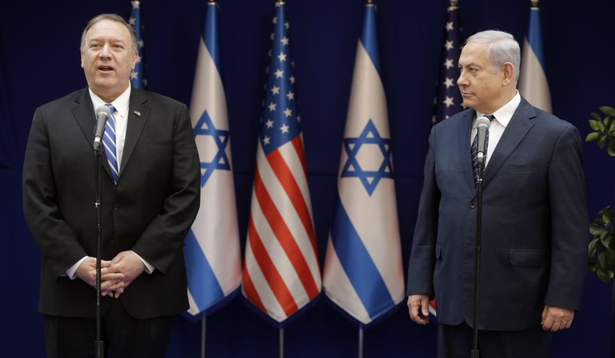 U.S. Secretary of State Mike Pompeo, left, and Israeli Prime Minister, Benjamin Netanyahu, stand during statements to the press during a meeting at the Prime Minister's residence in Jerusalem, Friday, Oct. 18, 2019. (AP Photo/Sebastian Scheiner, Pool)