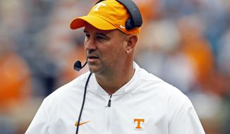 Tennessee head coach Jeremy Pruitt watches during the second half of an NCAA college football game against Mississippi State, Saturday, Oct. 12, 2019, in Knoxville, Tenn. (AP Photo/Wade Payne)