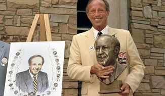 FILE - In this Aug. 3, 1985, file photo, Pete Rozelle poses with a bronze bust of himself after induction ceremonies into the Pro Football Hall of Fame, in Canton, Ohio. (AP Photo/Ernie Mastroianni, File)