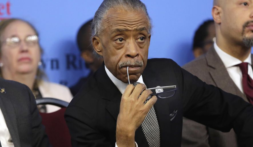 In this Monday, Jan. 15, 2018 file photo, Rev. Al Sharpton listens to remarks at the National Action Network House of Justice, in New York. (AP Photo/Richard Drew, File)
