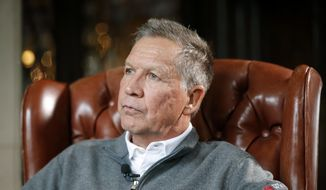 In a Dec. 13, 2018, file photo, then-Ohio Gov. John Kasich sits for an interview with The Associated Press in Columbus. (AP Photo/John Minchillo, File)