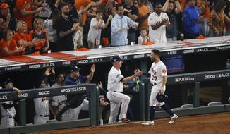 Houston Astros second baseman Jose Altuve celebrates at the dugout after scoring on a fielders choice during the sixth inning in Game 6 of baseball's American League Championship Series against the New York Yankees Saturday, Oct. 19, 2019, in Houston. (AP Photo/Sue Ogrocki)