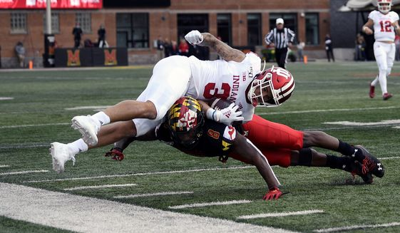 Indiana wide receiver Ty Fryfogle (3) is tackled by Maryland defensive back Marcus Lewis (8) during the first half of an NCAA college football game Saturday, Oct. 19, 2019, in College Park, Md. (AP Photo/Nick Wass)