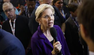 In this Oct. 15, 2019, photo, Democratic presidential candidate Sen. Elizabeth Warren, D-Mass., speaks in the spin room following a Democratic presidential primary debate at Otterbein University in Westerville, Ohio. (AP Photo/John Minchillo)