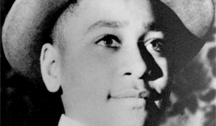 This undated file photo shows Emmett Till, a 14-year-old black Chicago boy, whose body was found in the Tallahatchie River near the Delta community of Money, Miss., Aug. 31, 1955. The Greenwood Commonwealth reports that a new historical marker was dedicated Saturday, Oct. 19, 2019, with members of Till's family in attendance. This is the fourth historical marker at the site. The first was thrown in the river. The second and third signs were shot at and became riddled with bullet holes. (AP Photo, File)