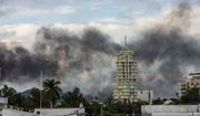 This Oct. 17, 2019 photo shows clouds of smoke from burning cars mar the skyline of Culiacan, Mexico. The Mexican city lived under drug cartel terror for 12 hours as gang members forced the government to free a drug lord. (AP Photo/Hector Parra)