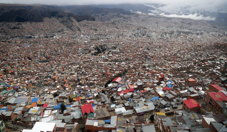 The capital city of La Paz is seen from El Alto, Bolivia, Friday, Oct. 18, 2019. Bolivia will hold general elections on Oct. 20, with President Evo Morales running for an unprecedented fourth term. (AP Photo/Jorge Saenz)