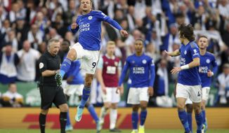 Leicester City's Jamie Vardy celebrates scoring his side's first goal of the game against Burnley, during their English Premier League soccer match at the King Power Stadium in Leicester, England, Saturday Oct. 19, 2019. (Nigel French/PA via AP)