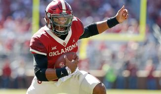 Oklahoma quarterback Jalen Hurts (1) runs against West Virginia during the first half of an NCAA college football game in Norman, Okla., Saturday, Oct. 19, 2019. (AP Photo/Alonzo Adams)