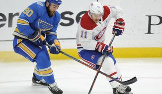 Montreal Canadiens' Brendan Gallagher (11) reaches for the puck with St. Louis Blues' Ryan O'Reilly (90) during the first period of an NHL hockey game, Saturday, Oct. 19, 2019, in St. Louis. (AP Photo/Bill Boyce)