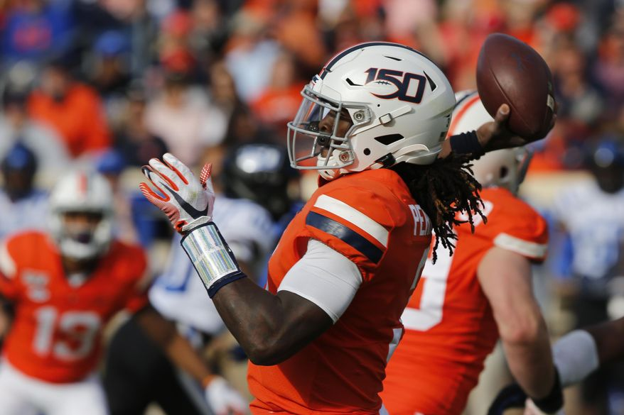 Virginia quarterback Bryce Perkins (3) tosses a pass during the first half of an NCAA college football game in Charlottesville, Va., Saturday, Oct. 19, 2019. (AP Photo/Steve Helber)