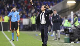Lyon's new coach Rudi Garcia reacts during the French League 1 soccer match between Lyon and Dijon, at the Stade de Lyon in Decines, outside Lyon, France, Saturday, Oct. 19, 2019. (AP Photo/Laurent Cipriani)