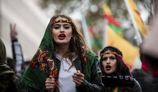 Participants of a Kurdish demonstration against the Turkish military offensive in Northern Syria demonstrate in Cologne, Germant, Saturday, Oct.19, 2019.  (Fabian Strauch/dpa via AP)