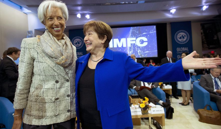 International Monetary Fund (IMF) Managing Director Kristalina Georgieva, right, speaks with former International Monetary Fund (IMF) Managing Director Christine Lagarde during the plenary of the International Monetary and Financial Committee (IMFC) meeting, at the World Bank/IMF Annual Meetings in Washington, Saturday, Oct. 19, 2019. (AP Photo/Jose Luis Magana)