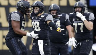 Vanderbilt quarterback Mo Hasan (18) celebrates with offensive lineman Tyler Steen (54) after a play against Missouri in the first half of an NCAA college football game Saturday, Oct. 19, 2019, in Nashville, Tenn. (AP Photo/Mark Humphrey)