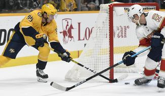 Florida Panthers defenseman Anton Stralman, right, of Sweden, blocks a shot by Nashville Predators center Matt Duchene (95) during the second period of an NHL hockey game, Saturday, Oct. 19, 2019, in Nashville, Tenn. (AP Photo/Mark Zaleski)