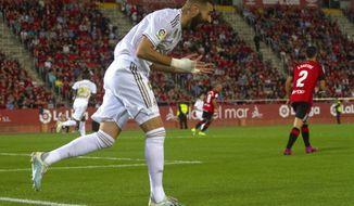 Real Madrid's Karim Benzema reacts during the Spanish La Liga soccer match between Mallorca and Real Madrid at the Iberostar Estadi in Palma de Mallorca, Spain, Saturday, Oct. 19, 2019. (AP Photo/Francisco Ubilla)