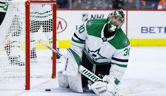 Dallas Stars' Ben Bishop looks on after making a save during the second period of an NHL hockey game against the Philadelphia Flyers, Saturday, Oct. 19, 2019, in Philadelphia. (AP Photo/Chris Szagola)
