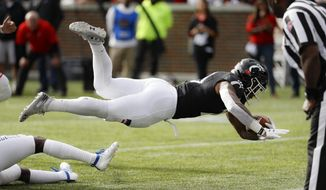Cincinnati running back Gerrid Doaks (23) dives for a touchdown during the first half of an NCAA college football game against Tulsa, Saturday, Oct. 19, 2019, in Cincinnati. (AP Photo/John Minchillo)