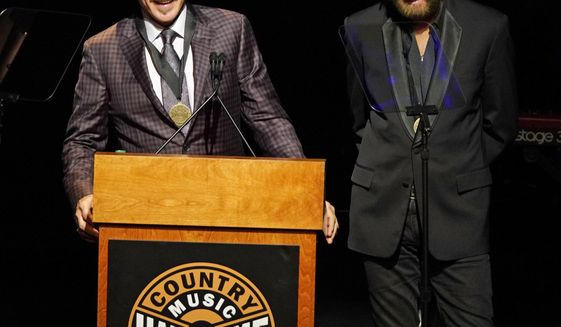 Kix Brooks, left, and Ronnie Dunn, right, speak after being inducted into the Country Music Hall of Fame at 2019 Medallion Ceremony at the Country Music Hall of Fame and Museum on Sunday, Oct. 20, 2019 in Nashville, Tenn. (Photo by Sanford Myers/Invision/AP)