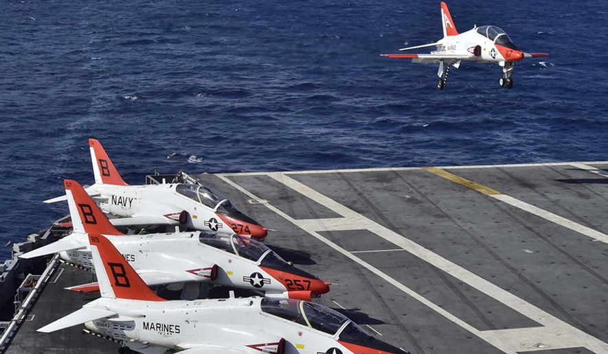 A T-45C Goshawk assigned to Carrier Training Wing (CTW) 2 lands on the flight deck of the aircraft carrier USS Dwight D. Eisenhower (CVN 69). Dwight D. Eisenhower is currently underway preparing for the upcoming Board of Inspection and Survey (INSURV) and conducting carrier qualifications. (U.S. Navy photo by Mass Communication Specialist 3rd Class Jameson E. Lynch/Released) 160204-N-QD363-122 Join the conversation: http://www.navy.mil/viewGallery.asp http://www.facebook.com/USNavy http://www.twitter.com/USNavy http://navylive.dodlive.mil http://pinterest.com https://plus.google.com