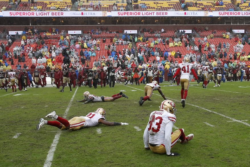 Members of the San Francisco 49ers celebrate after an NFL football game against the Washington Redskins, Sunday, Oct. 20, 2019, in Landover, Md. San Francisco won 9-0. (AP Photo/Alex Brandon)