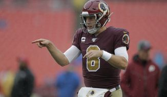 Washington Redskins quarterback Case Keenum warms up before an NFL football game against the San Francisco 49ers, Sunday, Oct. 20, 2019, in Landover, Md. (AP Photo/Julio Cortez)