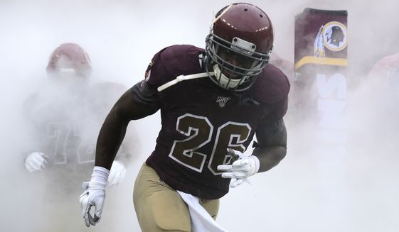 Washington Redskins running back Adrian Peterson runs onto the field prior to an NFL football game against the San Fransisco 49ers, Sunday, Oct. 20, 2019, in Landover, Md. (AP Photo/Mark Tenally)