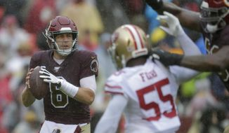Washington Redskins quarterback Case Keenum (8) looks for a receiver as he is pressured by San Francisco 49ers defensive end Dee Fordin in the first half of an NFL football game, Sunday, Oct. 20, 2019, in Landover, Md. (AP Photo/Julio Cortez)