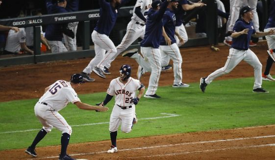Houston Astros' Jose Altuve rounds the bases after a two-run walk-off to win Game 6 of baseball's American League Championship Series against the New York Yankees Saturday, Oct. 19, 2019, in Houston. The Astros won 6-4 to win the series 4-2. (AP Photo/Sue Ogrocki)