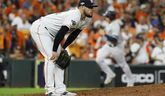 Houston Astros relief pitcher Roberto Osuna reacts after giving up a two-run home run to New York Yankees' DJ LeMahieu during the ninth inning in Game 6 of baseball's American League Championship Series Saturday, Oct. 19, 2019, in Houston. (AP Photo/Matt Slocum) ** FILE **