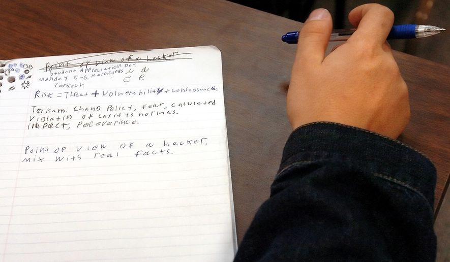 A student takes notes in the History of Domestic and International Terrorism class at Goodwin College in East Hartford, Conn., Wednesday, Sept. 13, 2006. (AP Photo/Jessica Hill)