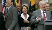 Speaker of the House Nancy Pelosi, D-Calif., center, laughs as her brother Thomas D' Alesandro III, right, makes a joke as he introduces her husband Paul, left, during a street renaming ceremony in her behalf,  Friday, Jan 5, 2007 in Baltimore. (AP Photo/Chris Gardner)