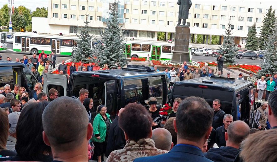 In this grab taken from a footage provided by the Russian State Atomic Energy Corporation ROSATOM press service, people gather for the funerals of five Russian nuclear engineers killed by a rocket explosion in Sarov, the closed city, located 370 kilometers (230 miles) east of Moscow, Monday, Aug. 12, 2019. Thousands of people have attended the burial of five Russian nuclear engineers killed by an explosion during tests of a new rocket. The engineers, who died on Thursday, were laid to rest Monday in the city of Sarov that hosts Russias main nuclear weapons research center. (Russian State Atomic Energy Corporation ROSATOM via AP)