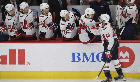 Washington Capitals' Tom Wilson (43) celebrates with teammates on the bench after scoring a goal during the third period of an NHL hockey game against the Chicago Blackhawks, Sunday, Oct. 20, 2019, in Chicago. Chicago won 5-3. (AP Photo/Paul Beaty)