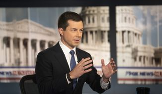 Democratic presidential candidate South Bend Mayor Pete Buttigieg, is interviewed by FOX News Sunday anchor Chris Wallace, Sunday morning, Oct. 20, 2019, in Washington. (AP Photo/Kevin Wolf)