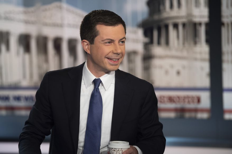 Democratic presidential candidate South Bend Mayor Pete Buttigie smiles following an interview by FOX News Sunday anchor Chris Wallace, Sunday morning, Oct. 20, 2019, in Washington. (AP Photo/Kevin Wolf)