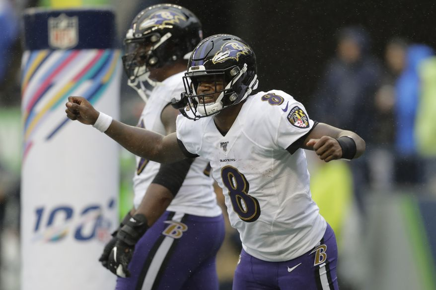 Baltimore Ravens quarterback Lamar Jackson (8) celebrates after he scored a touchdown against the Seattle Seahawks during the second half of an NFL football game, Sunday, Oct. 20, 2019, in Seattle. (AP Photo/John Froschauer)