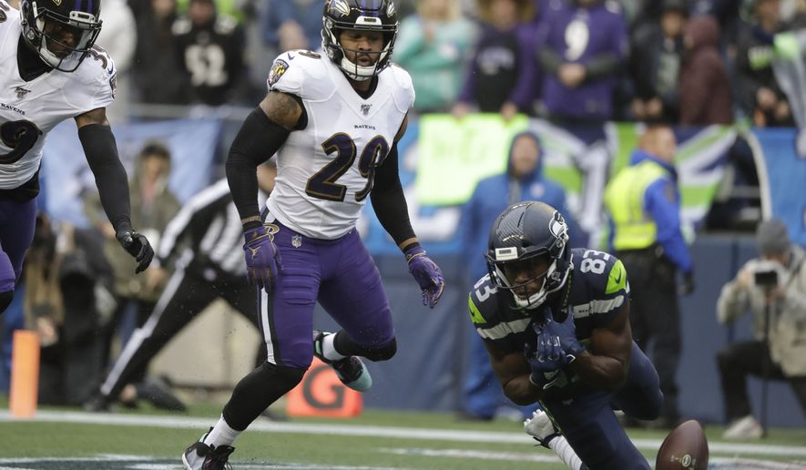 Baltimore Ravens free safety Earl Thomas (29) looks on as a pass to Seattle Seahawks wide receiver David Moore falls incomplete during the first half of an NFL football game, Sunday, Oct. 20, 2019, in Seattle. (AP Photo/Elaine Thompson) ** FILE **