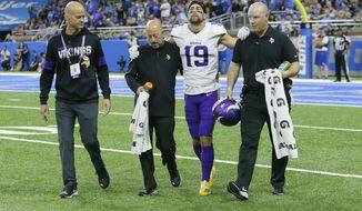 Minnesota Vikings wide receiver Adam Thielen (19) is helped off the field during the first half of an NFL football game against the Detroit Lions, Sunday, Oct. 20, 2019, in Detroit. (AP Photo/Duane Burleson) ** FILE **