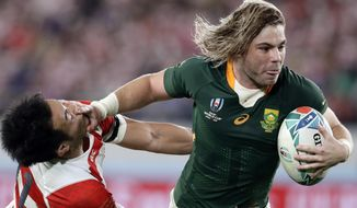 South Africa's Faf de Klerk runs to score a try during the Rugby World Cup quarterfinal match at Tokyo Stadium between Japan and South Africa in Tokyo, Japan, Sunday, Oct. 20, 2019. (AP Photo/Mark Baker)