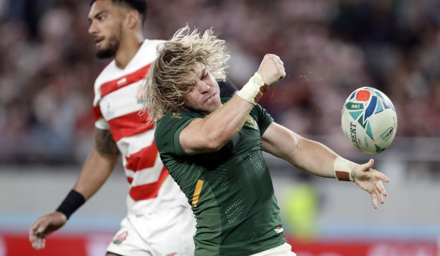South Africa's Faf de Klerk celebrates after scoring a try during the Rugby World Cup quarterfinal match at Tokyo Stadium between Japan and South Africa in Tokyo, Japan, Sunday, Oct. 20, 2019. (AP Photo/Mark Baker)