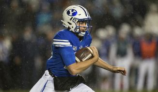 BYU quarterback Baylor Romney runs during the first half of the team's NCAA college football game against Boise State on Saturday, Oct. 19, 2019, in Provo, Utah. (AP Photo/Tyler Tate)