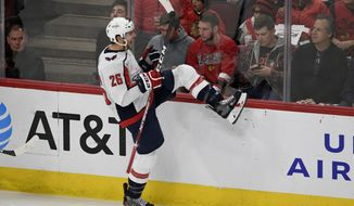 Washington Capitals' Nic Dowd (26) celebrates after scoring a goal during the second period of an NHL hockey game against the Chicago Blackhawks, Sunday, Oct. 20, 2019, in Chicago. (AP Photo/Paul Beaty)