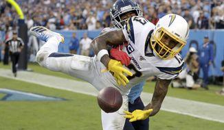 Los Angeles Chargers wide receiver Keenan Allen (13) can't hold onto a pass in the end zone as he is defended by Tennessee Titans cornerback Logan Ryan in the fourth quarter of an NFL football game Sunday, Oct. 20, 2019, in Nashville, Tenn. (AP Photo/James Kenney)