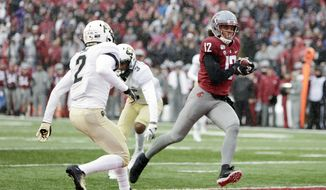 Washington State wide receiver Dezmon Patmon (12) runs for a touchdown in front of Colorado safety Mikial Onu (2) during the first half of an NCAA college football game in Pullman, Wash., Saturday, Oct. 19, 2019. (AP Photo/Young Kwak)