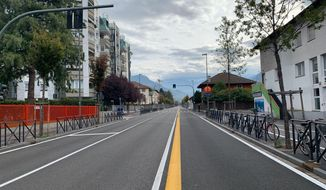 A view of a deserted road in the northern Italian city of Bolzano, Sunday, Oct. 20,2 019. Italian authorities have evacuated 4,000 people from the center of the northern city of Bolzano to defuse a World War II bomb found during construction. The news agency ANSA said the bomb was defused during a three-hour operation Sunday morning. (G.news/ANSA via AP)